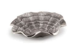 Ruffled Shell Bowl  STAR HOME: I'm always collecting beachy containers and kitchenware to take down to the beachhouse for gatherings. I pack them all up and lock them away for the next visit, so their use is extra special!