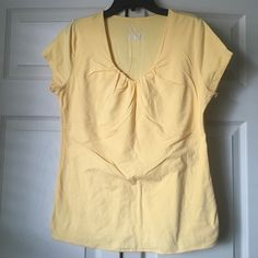 Women's Shirt Women's: beautiful Fall Yellow t-shirt; goes well w/jeans, black pants or tan color pants. Front has a double layer, so it's not see-through. Cute little rouching on the top. 93% Cotton/7% Spandex  **NOTE: this is a brighter yellow than in the pictures; see 3rd pic.  Ask any questions before purchasing!! 💝  🚭 Smoke Free House 🐶 Pet Free House ✅ Bundle Discount 👎 Low Ball Offers 🚫 No Trades/Offline Transactions/Other Sites Merona Tops