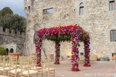 A 2000 yr old castle play a great backdrop for this Tuscany Italy wedding