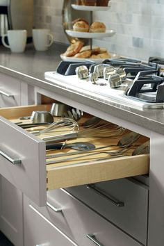 Open cabinets are ideal for displaying everything from cookbooks ...