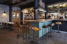 Pizza lovers' prayers are answered at eclectic three-storey Paris trattoria...