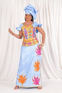 Sky blue African bazin with colorful embroidery ~Latest African Fashion, African Prints, African fashion styles, African clothing, Nigerian style, Ghanaian fashion, African women dresses, African Bags, African shoes, Kitenge, Gele, Nigerian fashion, Ankara, Aso okè, Kenté, brocade. ~DK