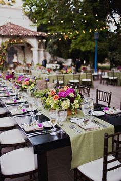 Colorful Wedding Dining Table #colorful #dining #wedding #green #pink #chairs #seating #vintage #vintagefurniture #specialtyrentals #vintagerentals