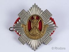 Nice example of this Royal Scots Regiment Cap Badge. Bi-metal badge complete with cloth backing and fixing lugs / pin to reverse