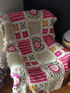 "Ravelry: Project Gallery for 139-39 ""Orange Blossom"" - Blanket with different squares in ""Paris"" pattern by DROPS design"