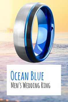 Mens ocean blue tungsten wedding ring. A wedding band for the ocean lover. Modern silver, black, and ocean blue. This mens wedding ring is designed with a brushed top featuring a blue carved channel. This makes one unique mens wedding ring.
