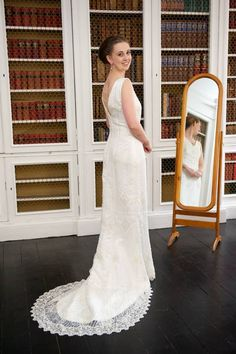 Emma's beautiful Art Deco couture lace with hand beaded low back details. Emma's bespoke dress glistened from head to toe created by ChantelleSophia