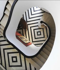 Make a bold statement! Continuous patterns that play off each other bring energy and interest to this black and white staircase.
