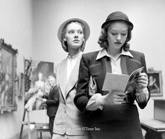"""Young women reading guidebook in a museum. Photograph by Nina Leen. LIFE Magazine, May 21, 1945. Image copyright Time Inc. The article called """"The American Look"""" appeared alongside wonderful images by photographer Leen. Asserting that during WWII, US GIs had traveled the world and found the world's women lacking in comparison to the """"girls back home,"""" the article is a charming celebration of the fresh-scrubbed American girl."""