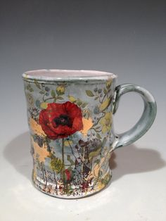 Cup with layered green glaze  poppies and gold decals by rothshank
