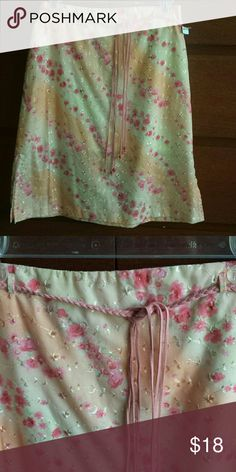 Spring Skirt Cute, cute, cute bright floral pattern skirt with braided belt. Never worn. Sales tags removed, but item still has a tag attached from boutique it was purchased at ~ Exact Change Skirts