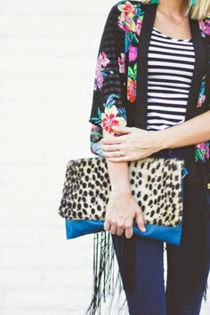Florals, stripes and leopard print all in the same outfit? Yup.This is pattern mixing done the right way.