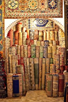 Hmmm... now which one of these is my flying carpet? Rug store, Morocco