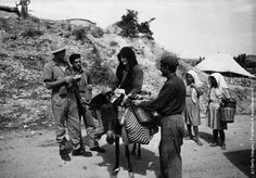 Greek regular soldiers search a peasant and his wife for arms, which are being smuggled to the Andartes rebels during the Greek Civil War. (Photo by Haywood Magee/Picture Post/Getty Images). October 1947