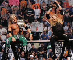 Edge and Christian win first tag titles.