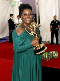 Loretta Devine is seen backstage with the award for guest actress in a drama at the 63rd Primetime Emmy Awards on Sunday. One of her many emmy's and other awards.