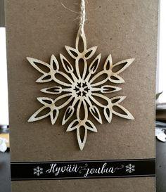 Joulukortti irroitettavalla koristeella.
