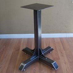 Heavy duty industrial grade steel cafe or bistro table base made for the heaviest tops.This steel table pedestal is made with square steel tube, heavy pl Welded Furniture, Steel Furniture, Industrial Furniture, Vintage Industrial, Steampunk Furniture, Industrial Bookshelf, Industrial Cafe, Industrial Living, Pipe Furniture