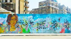 Ammar Abo Bakr's mural of an Egyptian woman featured the poetry of Ahmed Aboul Hassan painted in calligraphy by Sameh Ismail. Eagle-like scu...