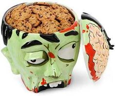 Zombies are to brains as humans are to cookies. This zombie head cookie jar is an attention grabbing cookie container that will allow you to keep your delicious cookies safe and sound. It makes a great kitchen accessory for zombie lovers.