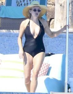 Reese's one-piece: Witherspoon stripped to a plunging black swimsuit in Cabo San Lucas, Me...