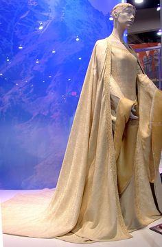 A yellow/gold gown worn by Miranda Otto as Eowyn during Aragorn's coronation in The Lord of the Rings, Return of the King