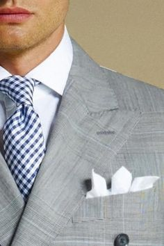 Grey suit with checked tie