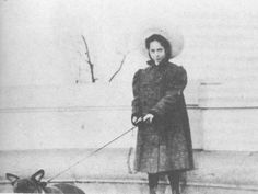 Dorothy Parker, age 13, in 1906 with her dog at Riverside Park's Soldiers and Sailors Monument at West 89th Street.