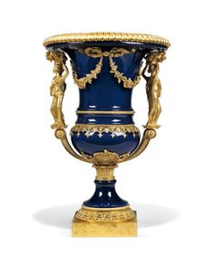 AN ITALIAN ORMOLU-MOUNTED BLUE PORCELAIN VASE BY VIGNI, FLORENCE, AFTER A MODEL BY PIERRE-PHILIPPE THOMIRE The rectangular plinth inscribed 'VIGNI A FIRENZE' - Dim: 27 in. (68.5 cm.) high; 18 in. (46 cm.) diameter