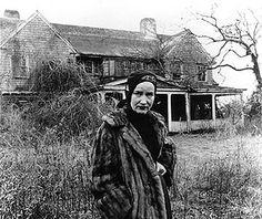 Little Edie in front of the rundown Grey Gardens wearing her fusty old furcoat.