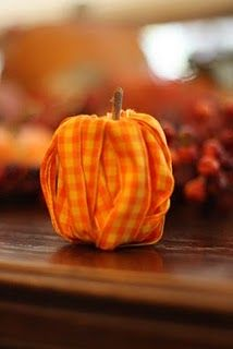 Pumpkin made from an empty spool of thread, orange ribbon, and a twig...how about an apple too?