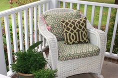 Love the idea of putting a couple of wicker rocking chairs on the porch with some bold print on the cushions.