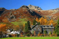 Langdale in Lake District - England  Surrounded on all sides by towering peaks, saw-tooth ridges and scree-strewn slopes, the Langdale Valley is one of the most dramatic sights in the Lake District. Beautiful for multi-day hikes.