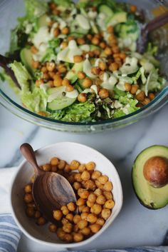 A vegan quasi-Caesar salad with roasted spiced chickpeas, avocado, cucumber, capers and creamy tangy dressing.