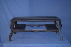 sliding shelf table,walnut and maple top acacia legs and walnut shelves.  2012   [ sold ]