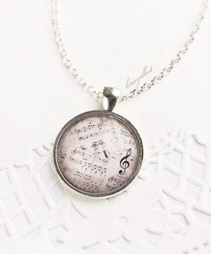 Hey, I found this really awesome Etsy listing at http://www.etsy.com/listing/127174791/romantic-music-necklace-round-pendant