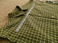 Turn A Shirt Into A Pillow by cutting it into a square, sewing all 4 sides then stuffing a pillow inside and button it back up