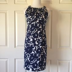 TAYLOR DRESS Beautiful blue floral pattern on this sleeveless Taylor dress. 96% cotton 4% spandex. The lining is 97% polyester and 3% spandex. The length is 33 1/2 inches shoulder to hem with a 20 inch zipper down the back. This dress is in wonderful, like new condition. No trades or Paypal. Thank you for stopping by @treasuresbytrac  Taylor Dresses
