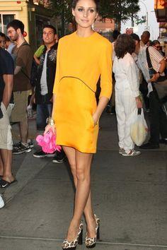 Olivia Palermo wearing a mustard color Victoria Beckham dress