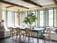 In the kitchen of his family's Martha's Vineyard escape, restaurateur Keith McNally has combined a custom-made banquette upholstered in a fabric from Paula Rubenstein with a table made from reclaimed wood.