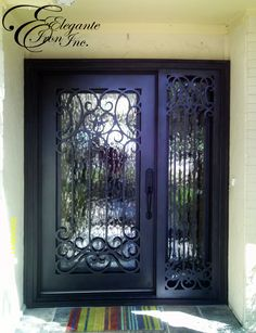 Custom wrought iron door with attached sidelight. Doors, Black Kitchen Faucets, Woven Wood Blind, Brick Accent Walls, Decorative Fence Panels, Wood Tv Stand Modern, Wrought Iron Doors, Green Accent Walls, Wrought Iron Front Door