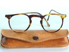Vintage Pre O'malley by Oliver Peoples glasses. i wish i could afford these...