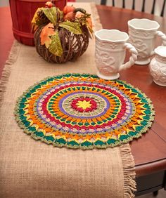 Mandala Doily free crochet pattern. We've used fall colors for this beautiful mandala design, but we encourage you to crochet yours in your own unique color combination. Use it to add interest to a table setting or tray, or frame it for a wonderful art piece. Skill Level: Intermediate Pattern More Patterns Like This!