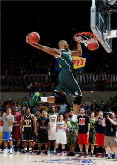 Adreian Payne  dunks  TWO basketballs after first high- scoring 360.  Lacey was right in front row cheering!  NCAA Slam Dunk Contest