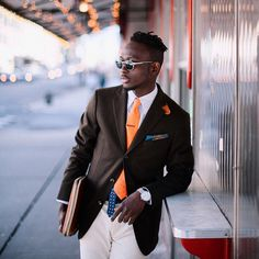 Steven Onoja  Nigerian-born Steven Onoja identifies a couple of things (or twenty) regarding the power of color. From navy blue tweeds to orange and burgundy ties and pocket squares, Onoja's Instagram page is usually a lesson in color play.