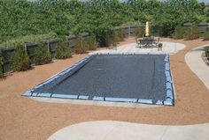 Cover your swimming pool with a mesh cover from Doheny's Pool Supplies Fast.  www.doheny.com