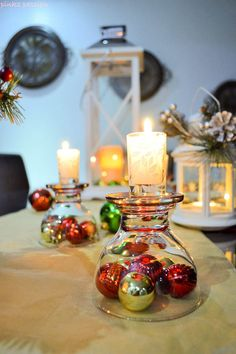 Holiday tablescape with upside down glasses as candle holders