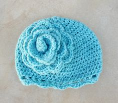 crocheted hat and flower