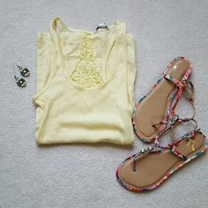 American Eagle tank top Light yellow tank top with lace detail on back and lightly ribbed fabric. Soft, cotton blend. Fun color and great for summer! Worn once, looks new. Size XS. American Eagle Outfitters Tops Tank Tops