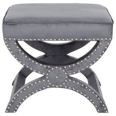 "Inspired by cozy abodes and soothing hues, this beautifully crafted design transforms your home into a well-appointed retreat.     Product: Ottoman  Construction Material: Pinewood and plywood  Color: Pewter gray  Features: Nailhead detail  Dimensions: 19"" H x 21.5"" W x 21.5"" D"